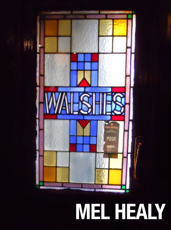 The stained glass door of Walshes pub in Stoneybatter, Dublin