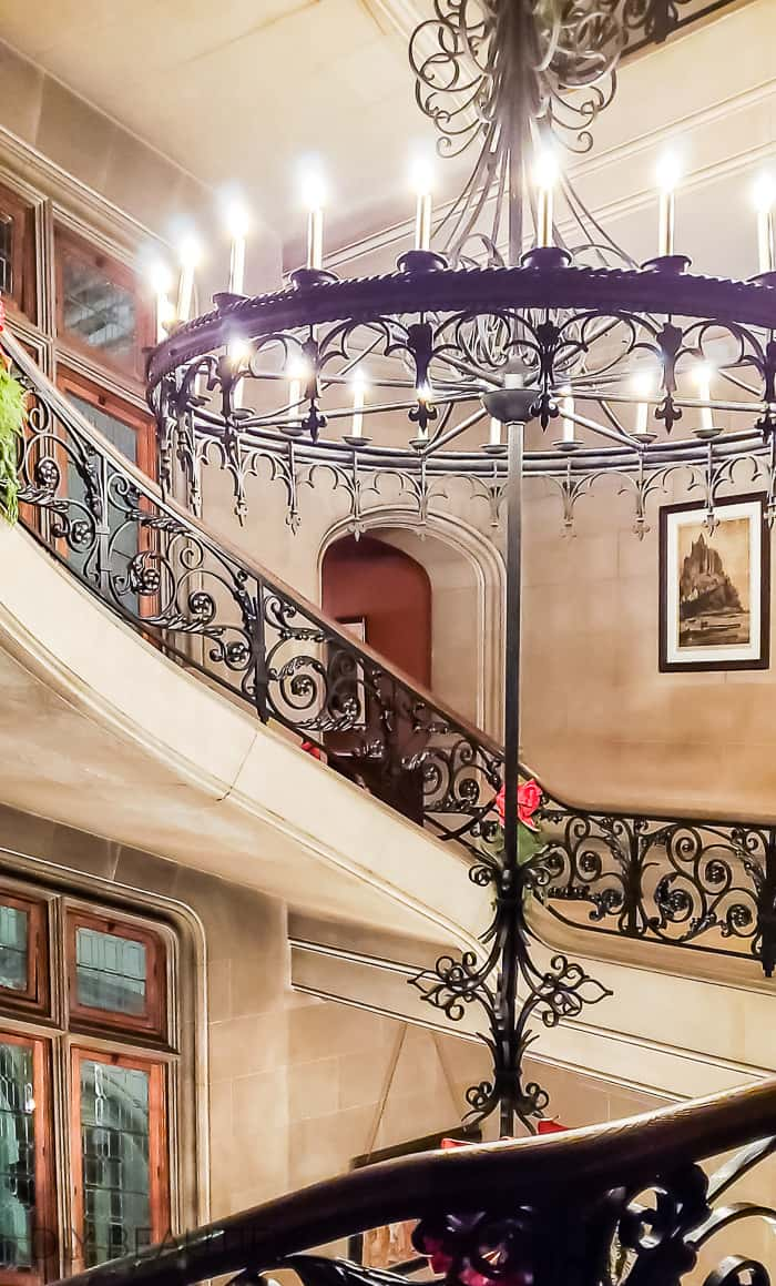 iron chandelier and staircase