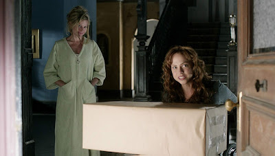 Movie scene from the 2013 horror film Curse of Chucky where Nica (Fiona Dourif) receives a package in the mail