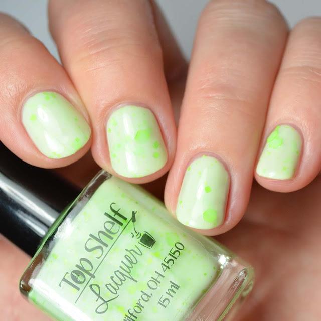 green nail polish with neon green glitter
