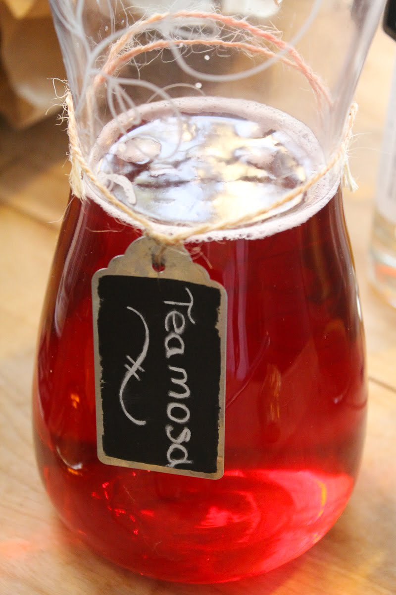 Teamosa has a jewel-like red color. Shown here in a glass pitcher with a chalkboard label.