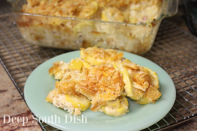 Classic squash casserole made with summer squash, seasoned with bacon and onion, and tossed with cheese, eggs, mayonnaise and seasonings, baked with a cracker topping.