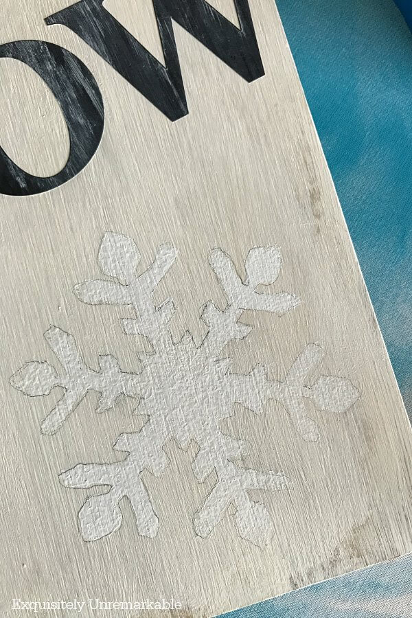 Painting Snowflakes on a board with pencil outlines