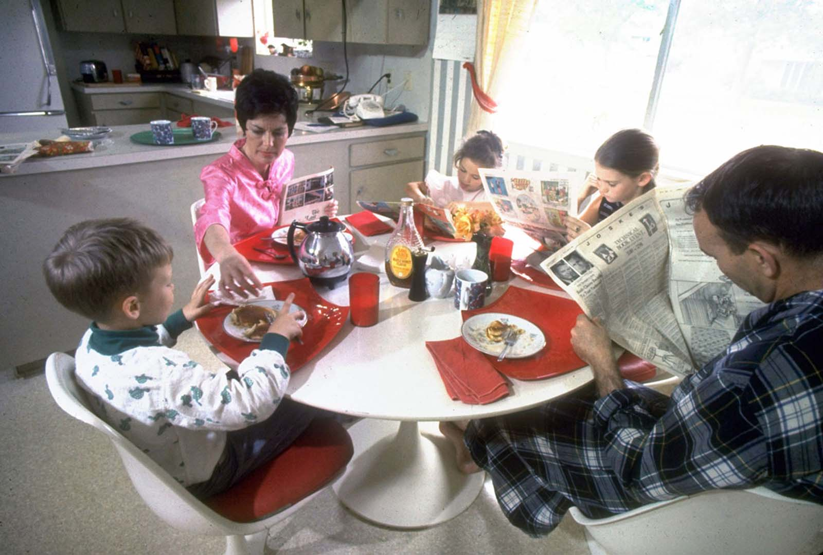 From a Life magazine series on the Apollo astronauts at home, a photo of Michael and Pat Collins and their children enjoying a relaxing pancake breakfast in March 1969.