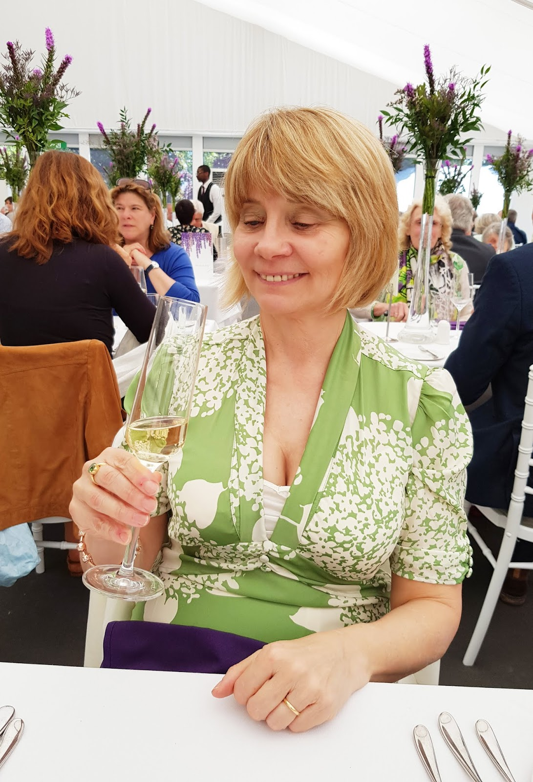 Enjoying a glass of champagne in the Rock Terrace restaurant at the Chelsea Flower Show