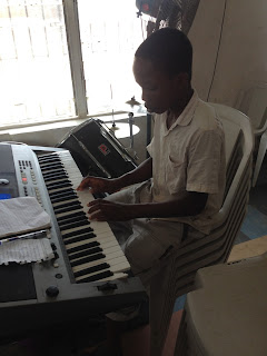 young nigerian child playing be magnified by don moen