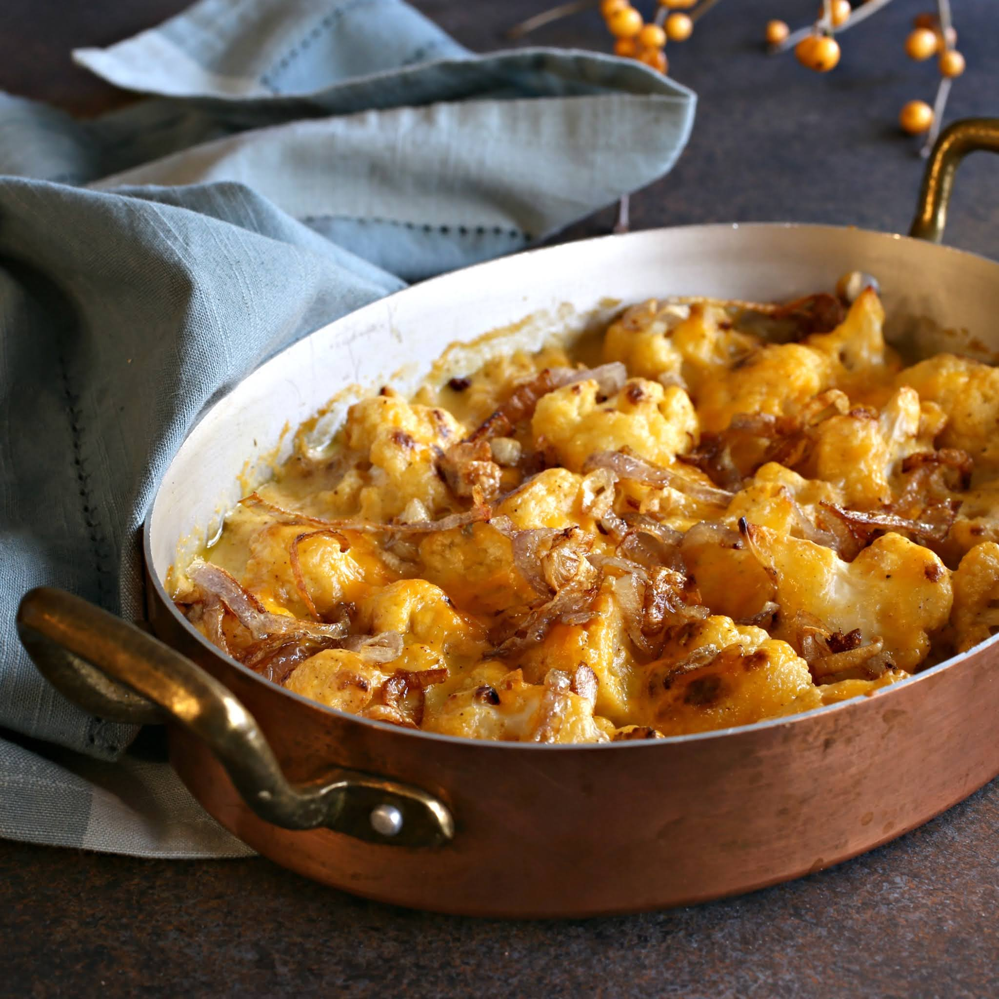 Recipe for a cheddar cheese cauliflower gratin topped with fried shallots.