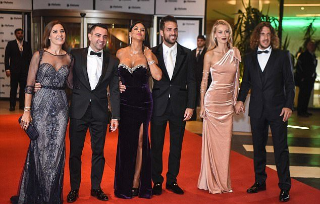 Former Barcelona players Xavi Hernandez, Cesc Fabregas and Carles Puyol and their Wives