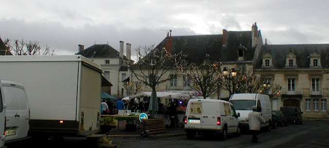 Place des Halles, Preuilly sur Claise, decorated for Christmas.  Indre et Loire, France. Photographed by Susan Walter. Tour the Loire Valley with a classic car and a private guide.