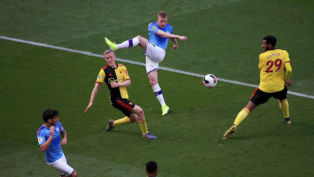 Manchester City 8-0 Watford Kevin De Bruyne unleashes a powerful shot as Man City pile the pressure on Watford