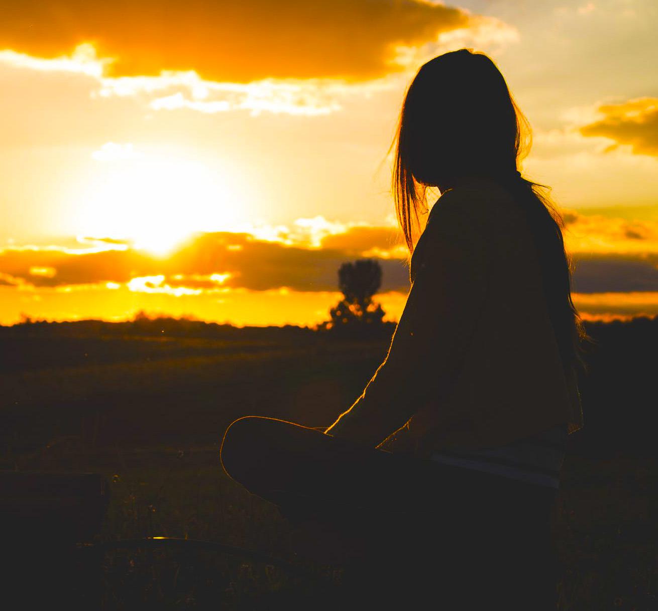 sad girl in sunrise