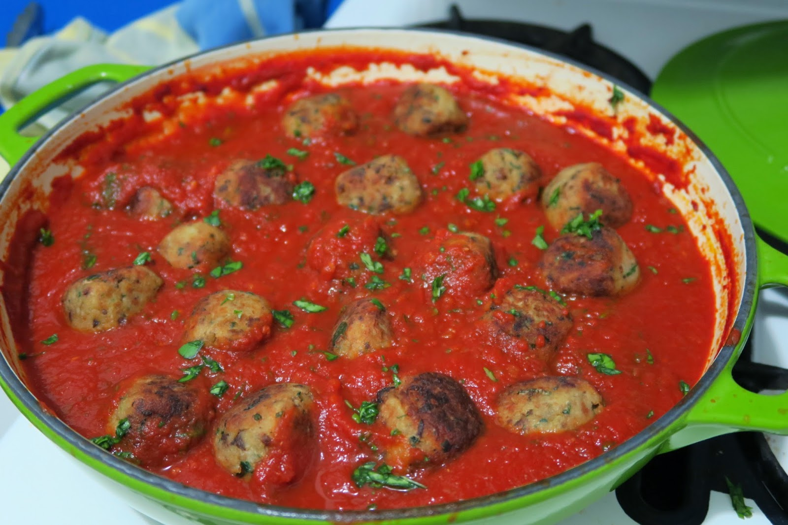 Eggplant and porcini meatless meatballs with tomato sauce.