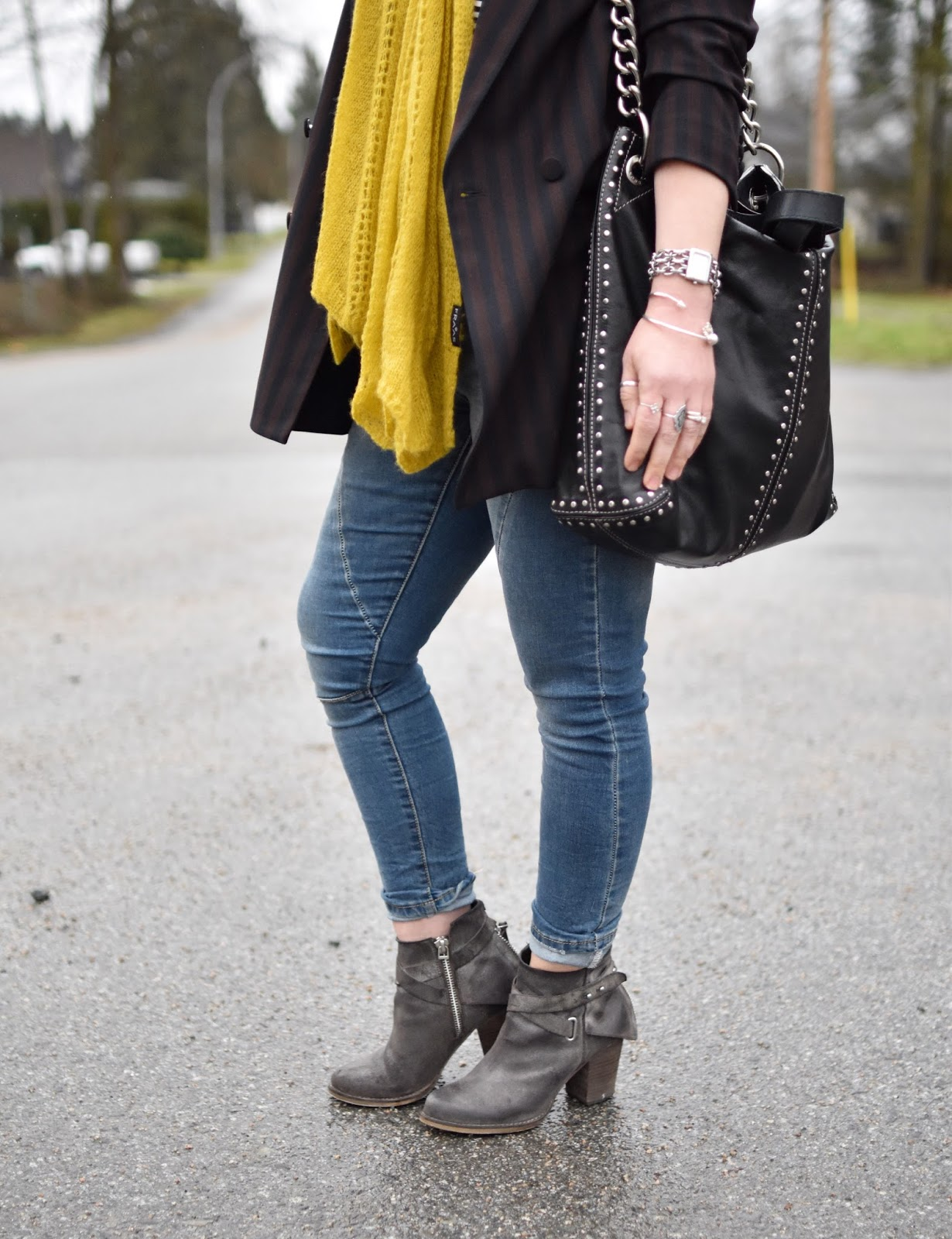 Monika Faulkner outfit inspiration - double-breasted suit jacket, skinny jeans, booties, mustard scarf, MK studded bag