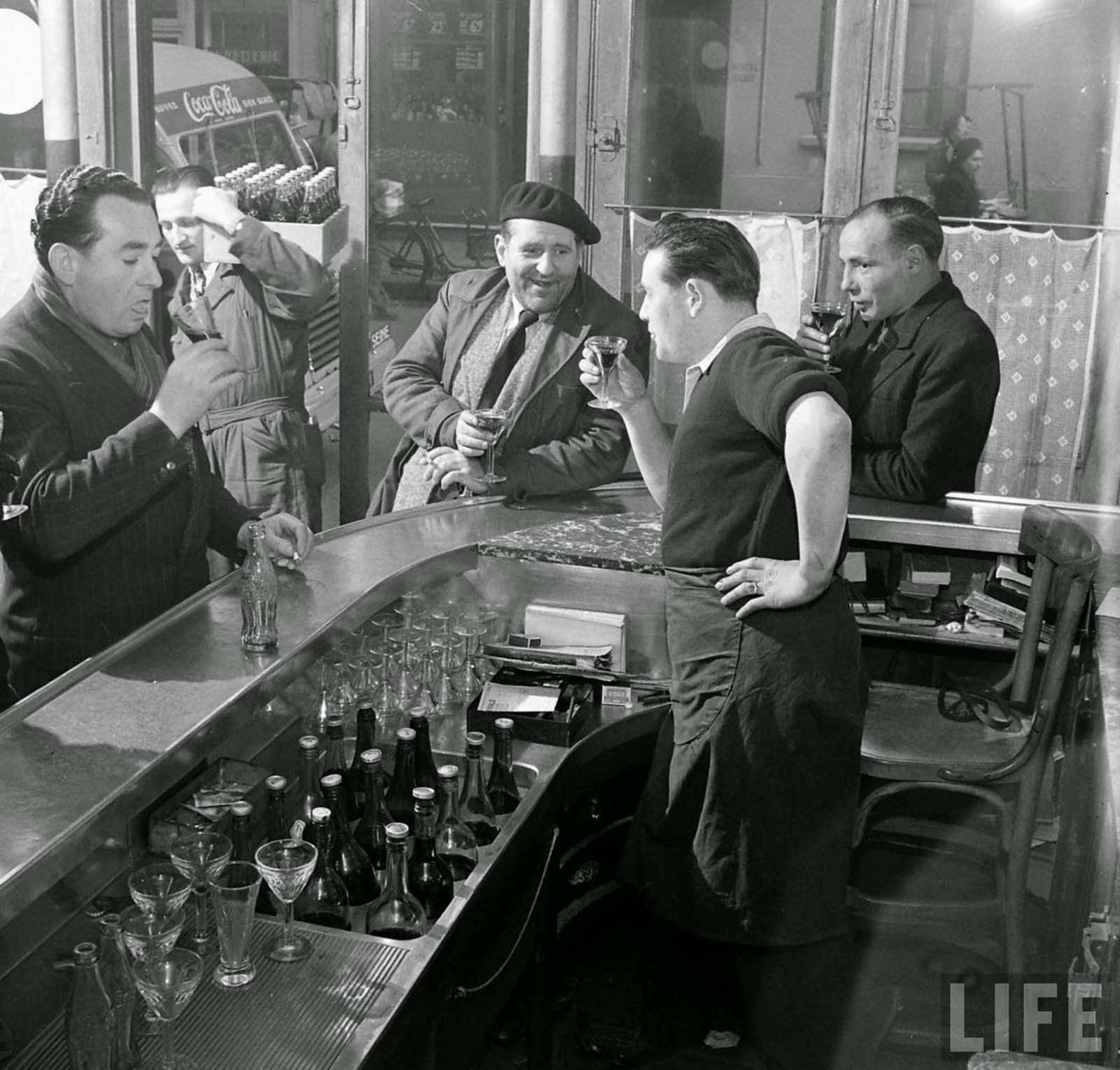 A group of people trying the Coca Cola.