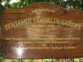 the wooden sign that outside the garden that says Benjamin Franklin Garden