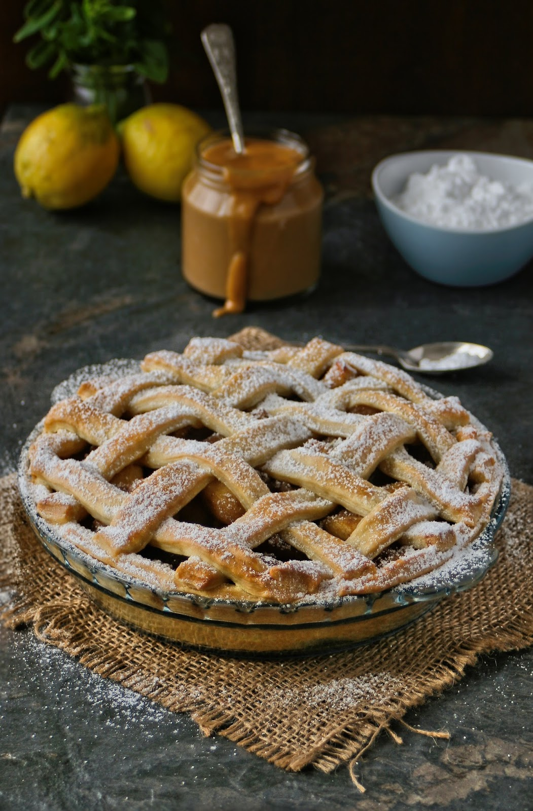 Apple pie with lattice crust and creamy caramel custard.