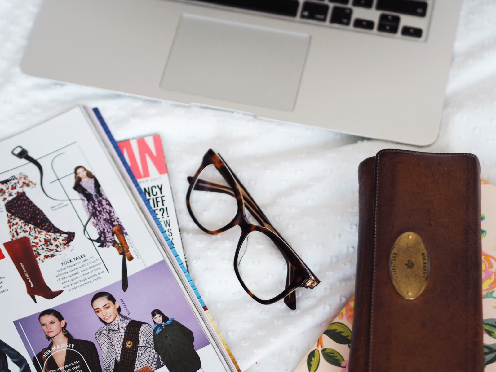 Money | Hacks to Save Money Shopping Flatlay Purse Magazine Glasses MacBook