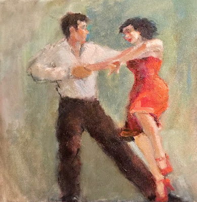 man with woman in red and tangerine dress dancing a tango