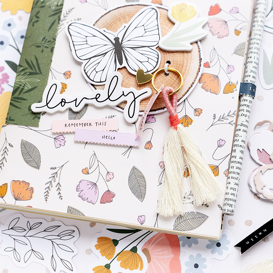 Close Up of a mini album with the Peaceful Heart Collection by Jen Hadfield with a lovely tassel and ephemera pieces from the collection