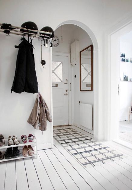 arch foyer entry hall entrance home house all white decor design wood floors shoe coat rack