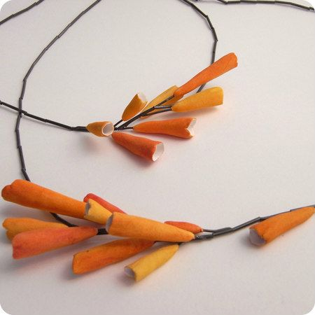 handmade orange paper necklace on black necklace