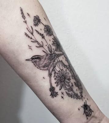 flying ladybug tattoo