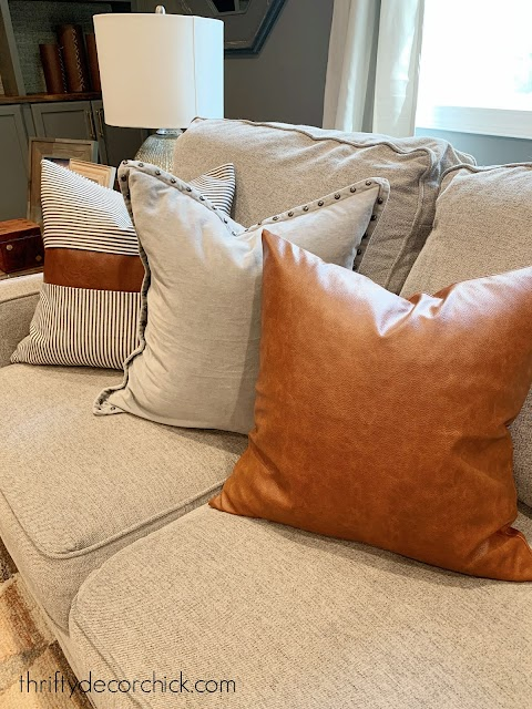 mixing leather and stripe pillow covers