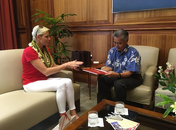 Princess Charlene of Monaco visited Honolulu, Hawaii met Governor David Idge. She wore red shirt and white pants