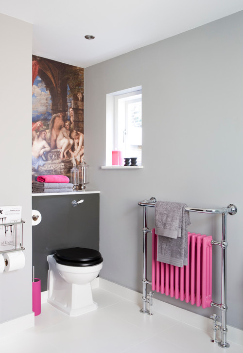 pink cast iron radiator with towel rail