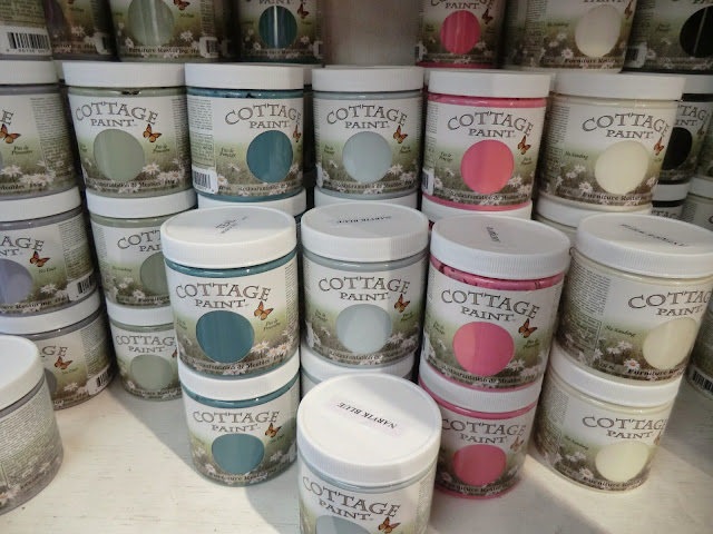 There are 55 colours in Cottage Paint - this photo shows various jars of paint.