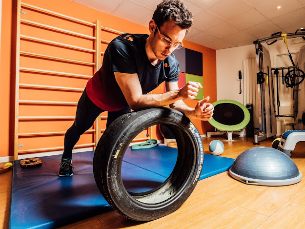 Thierry Neuville exercising with a rally tyre