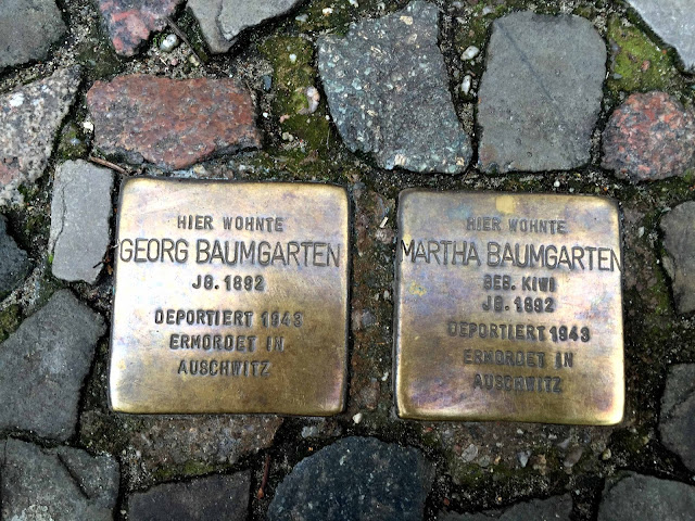Two golden stumbling stones in memory of deported and murdered Jews.