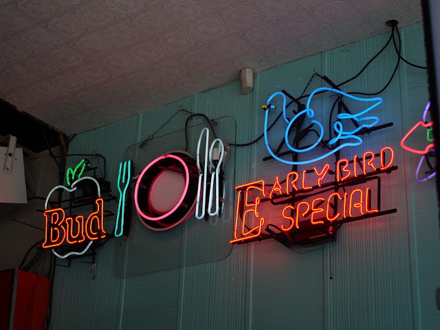 Different signage with colorful neon lights