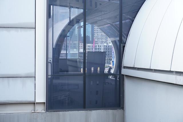 Abandoned Harborside Monorail Station through window