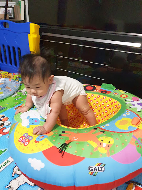 My 5-and-a-half-month-old learning to push herself to stand in the Galt Playnest