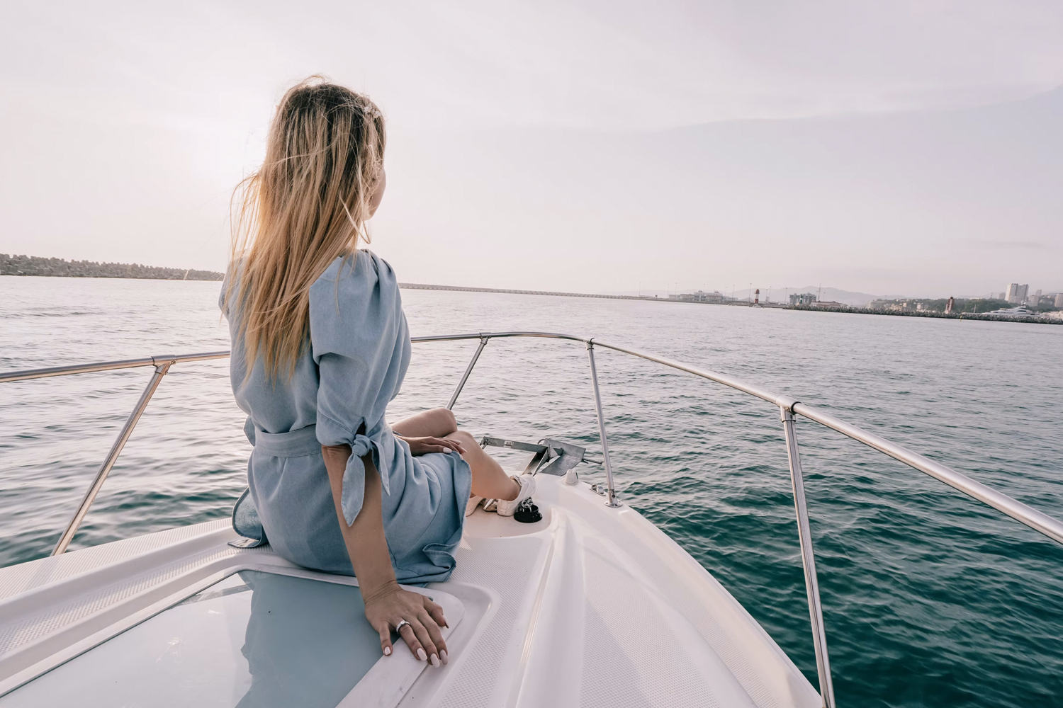 woman in a nautical outfit on a yacth