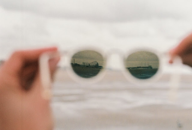transitions lens clear frame glasses by cubitts on blackpool beach