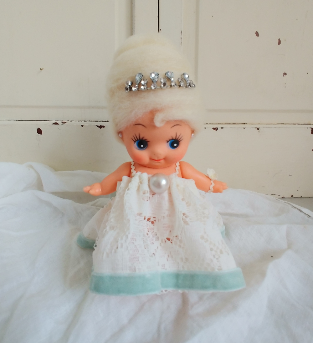Kewpie doll with a beehive