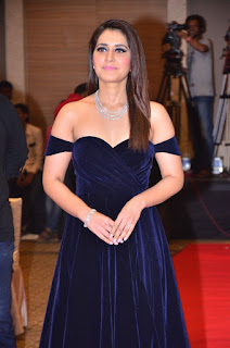 Raashi Khanna in a Deep neck Blue Gown at Jai Lava Kusa Audio Launch Stunning Pics