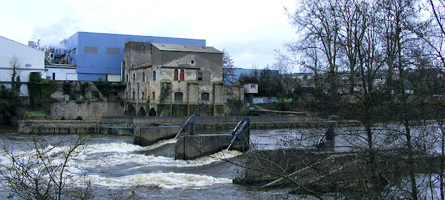 Weir on the Creuse at the papermill, Descartes.  Indre et Loire, France. Photographed by Susan Walter. Tour the Loire Valley with a classic car and a private guide.