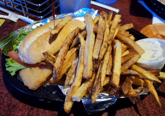 Fish sandwich and fries from the menu at Bummies Pub & Grub in Newark Ohio