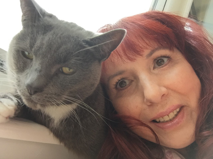 grey and white cat with woman with red hair