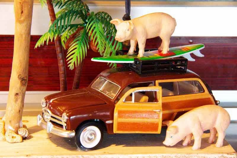 display, classic car and surfing pig