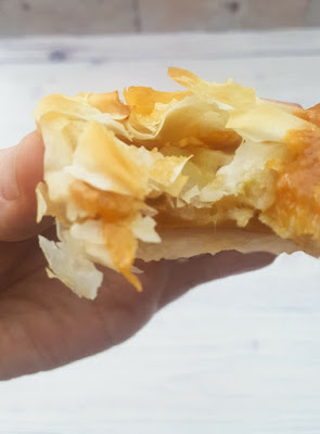 close up of a caramel banana hand pies with a bite out of it, showing banana and caramel centre