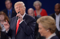 Hillary Clinton mentioned climate change during the second presidential debate, as part of her answer to a question on the nation's production of energy. Donald Trump did not. The debate moderators did not ask about climate change. (Credit: Saul Loeb/AFP/Getty Images) Click to Enlarge.
