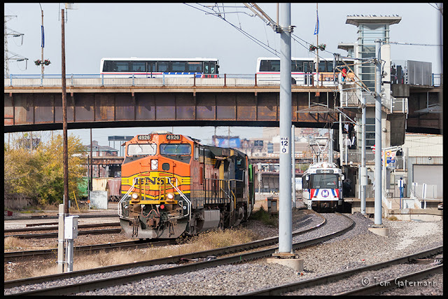 BNSF 4926 rolls east through Grand Avenue Interlocking, next to the Metrolink Station.