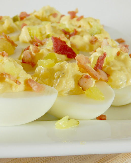 Dill Pickle & Bacon Deviled Eggs...the perfect way to use up those holiday boiled eggs!  Creamy, tangy, salty and down right delicious.  Makes 24 - they feed a crowd well. (sweetandsavoryfood.com)