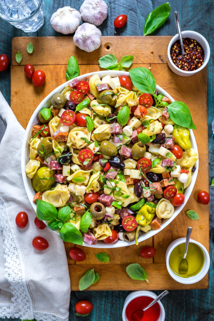 This packed potluck favorite includes multiple cheeses, meats, olives, peppers, and more to create a hearty Italian-inspired summer side dish.