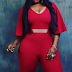 Anita Joseph squeezes her sexy curves into red jumpsuit