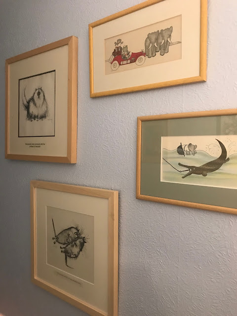 Four framed pictures of animals.